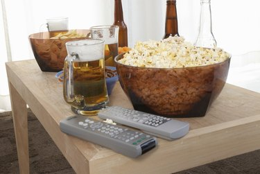Popcorn, beer, and remote controls on coffee table