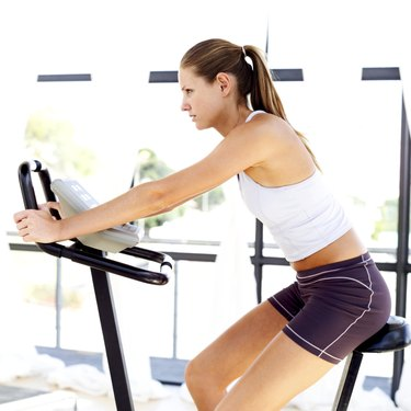 young woman working out on an exercise machine