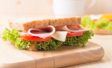 sandwich on wood plate.