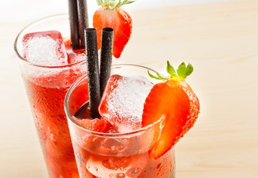 detail of two glasses of strawberry cocktail with ice