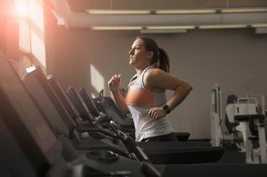 Female running on treadmill