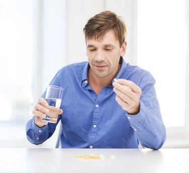 ill man taking his pills at home