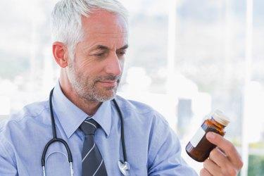 Doctor looking at medicine jar