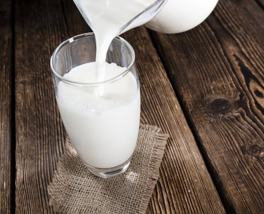 Milk on a dark wooden background