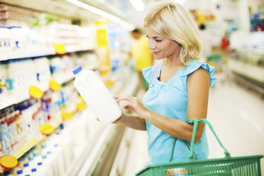 Female buying dairy products.