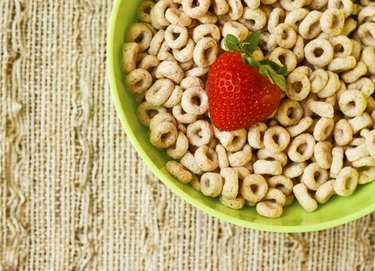 Bowl of cheerios  with a strawberry
