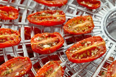 sundried cherry tomatoes on food dehydrator tray
