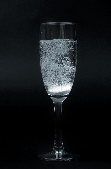 effervescent pill in glass