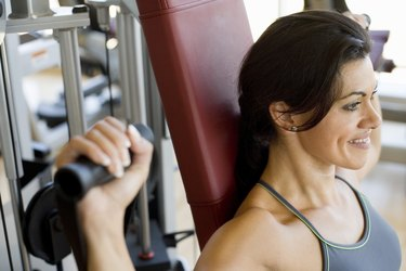 Woman doing shoulder exercises on an exercise machine