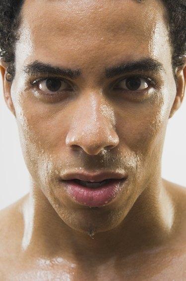 Close up of Mixed Race man's wet face