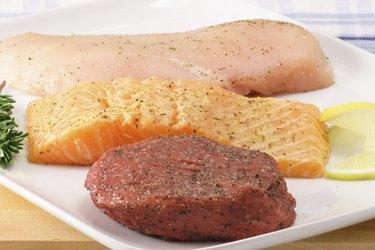 three raw meats