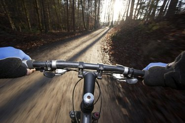 Person driving mountain bike (blurred motion)