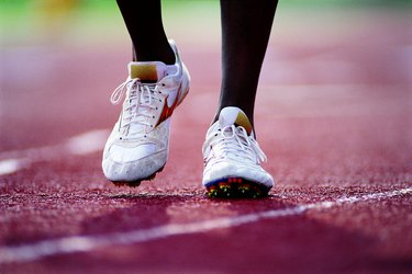 Feet of runner on track