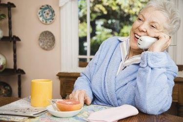 Senior woman talking on telephone