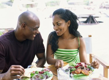 Side view of a young couple eating