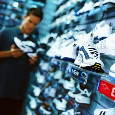 portrait of a young man looking at shoes in a shoe store