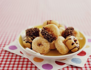 Assortment of doughnuts on plate, close-up