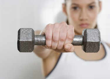 Young woman holding a dumbbell