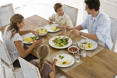 High angle view of family eating dinner together