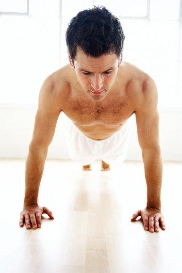 a young man doing pushups