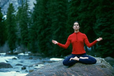 Young woman meditating in the lotus position