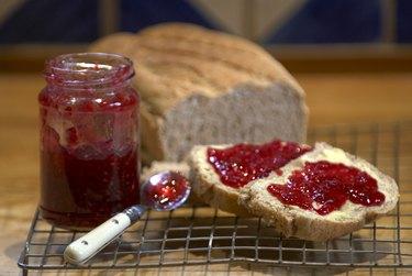 Strawberry jam on crust of bread