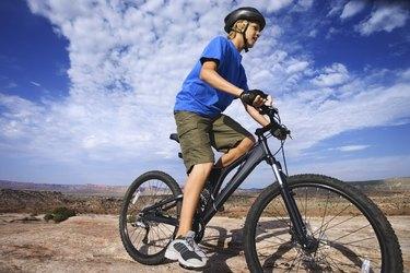 Teenage boy riding bicycle