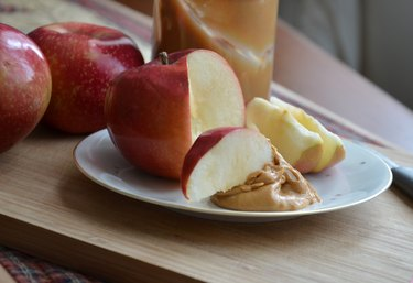 Apples Slices Dipped in Peanut Butter