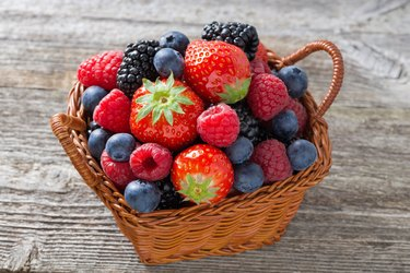 basket with fresh seasonal berries, top view