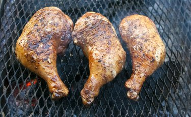 Chicken legs grilling  on a barbecue