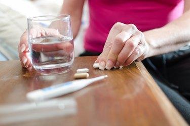 Sick woman taking drugs