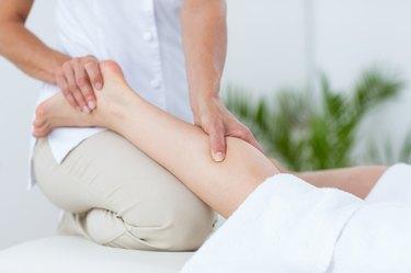 Physiotherapist doing leg massage