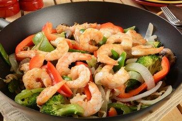 Shrimp stir fry in a wok