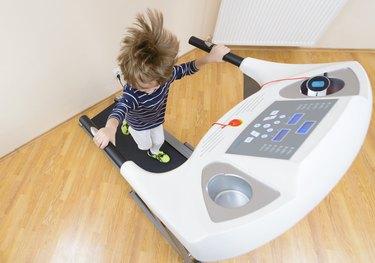 Boy running treadmill