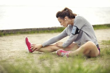Woman Stretching Her Legs Before Workout