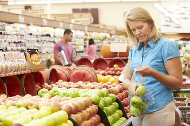 Woman At Fruit Counter In Supermarket
