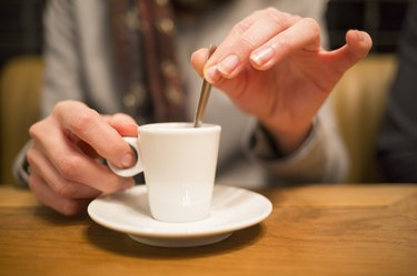Close up of hands woman and cup of coffee