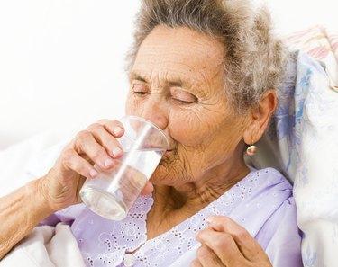 Senior Woman Taking Supplements