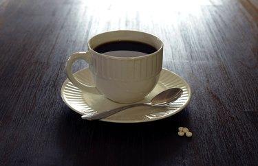 Coffee, white mug, saucer, teaspoon, sugar on table 1