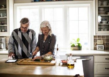 Senior couple preparing dinner