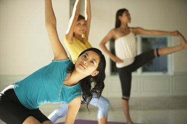 Young women practicing yoga  poses