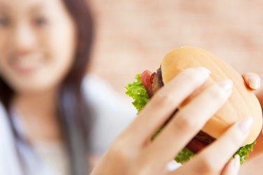 Young woman eating a hamburger