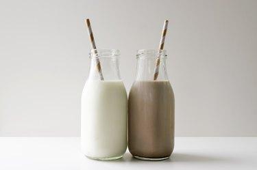 milk jugs regular and chocolate touching on white