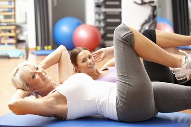 Women Doing Stretching Exercises In Gym