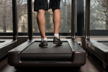 Man Feet On Treadmill