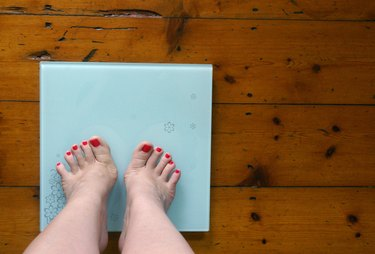 Woman weighing hersel