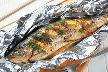 Baked trout with lemon and dill.