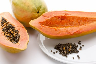 Hollowed Out Papaya Half And Its Peppery Seeds