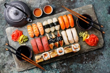 Sushi Set nigiri and sushi rolls with tea
