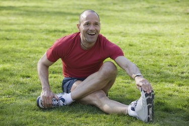 Hispanic man exercising in a park and smiling